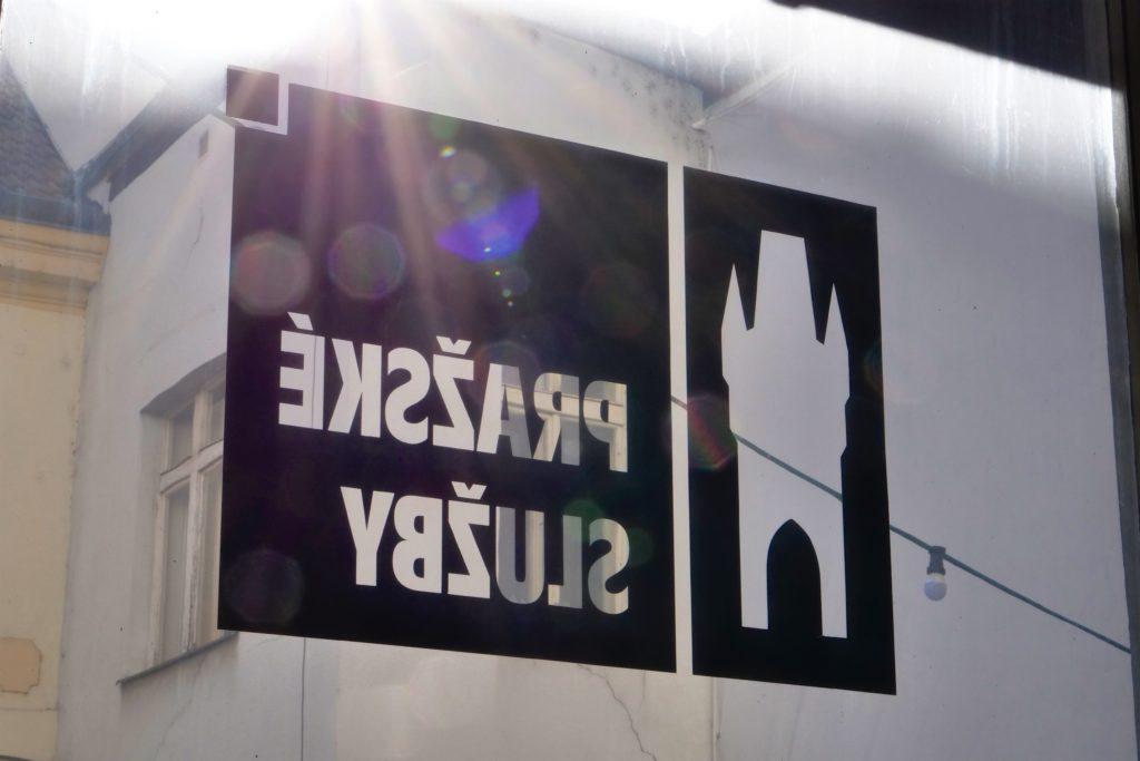 Pražské služby, logo